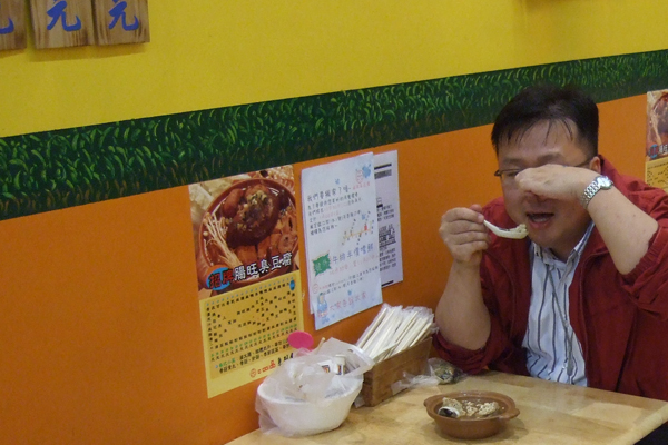 Stinky tofu being eaten in Taipei.