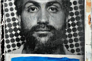 Palestinian man picture on separation wall