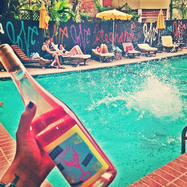 A bottle of wine beside the pool at Freehand Miami