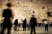 Blurred figures at the Western Wall