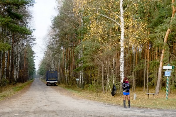 Woman on road in forest
