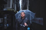 A person in an alley with an umbrella