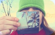 A person holding a pic with palm trees
