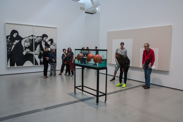 "Visitors admire ""Three Ball 50/50 Tank,"" by Jeff Koons, at the Broad Museum of Contemporary Art. Koons' work, ""Balloon Dog (Orange),"" recently sold for over $50 million dollars, making it the most expensive sale by a living artist in history. ""Balloon Dog (Blue)"" is also hosted at the Broad."