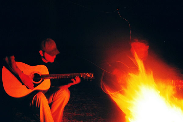 campfire guitarist