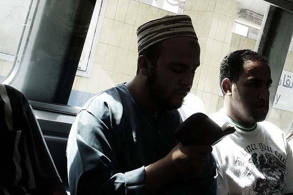 reading koran on train
