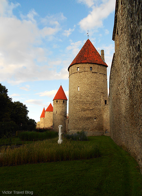 The old town of Tallinn is surrounded by stone walls and distinctive red roofs.