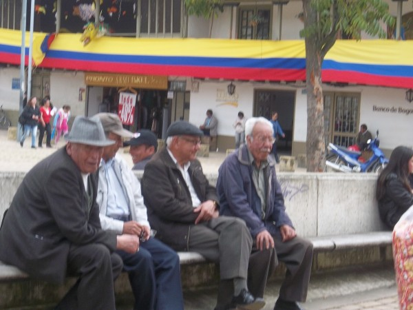 Colombian men that gather in the square to people watch and laugh