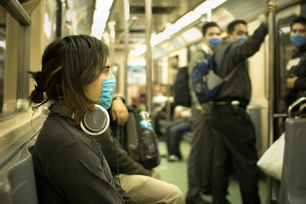 Woman on subway wearing mask