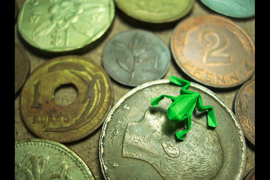tiny green frog origami on coins