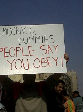 sign saying democracy for dummies, Egypt