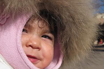 inuit baby in a fur hood