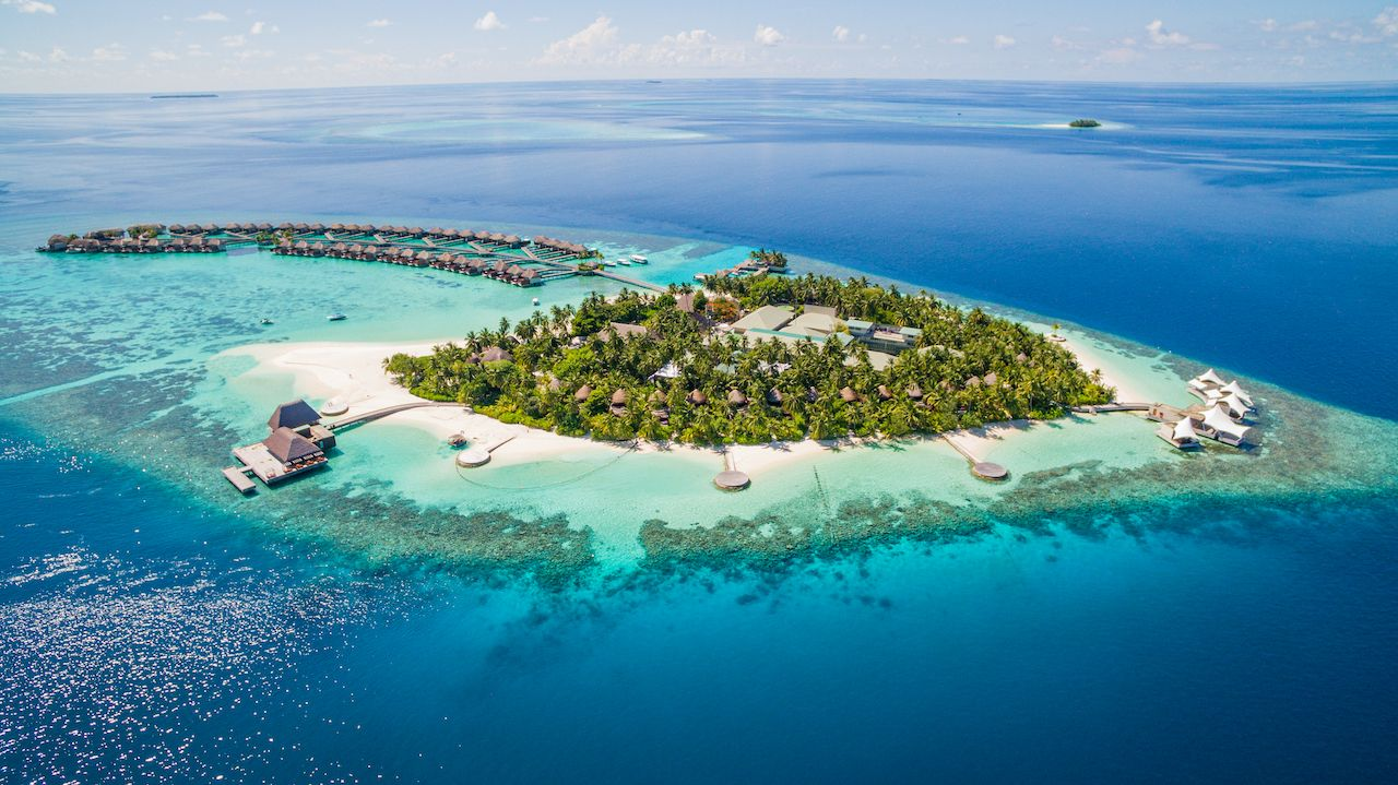 Aerial view of the Maldives archipielago with luxury bungalows