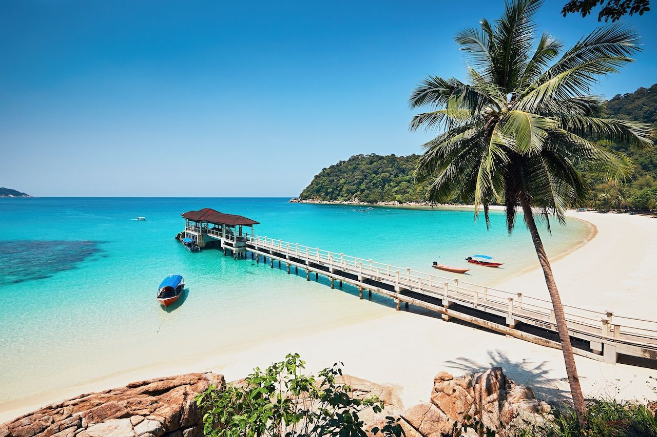 Beach with clear turquoise water in Perhentian Islands in Malaysia