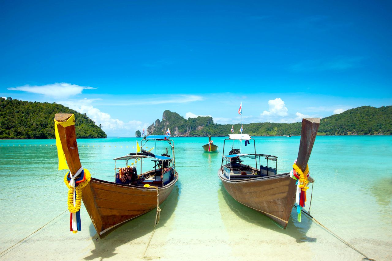 Clear waters of Phi Phi Island in Krabi Thailand with boats