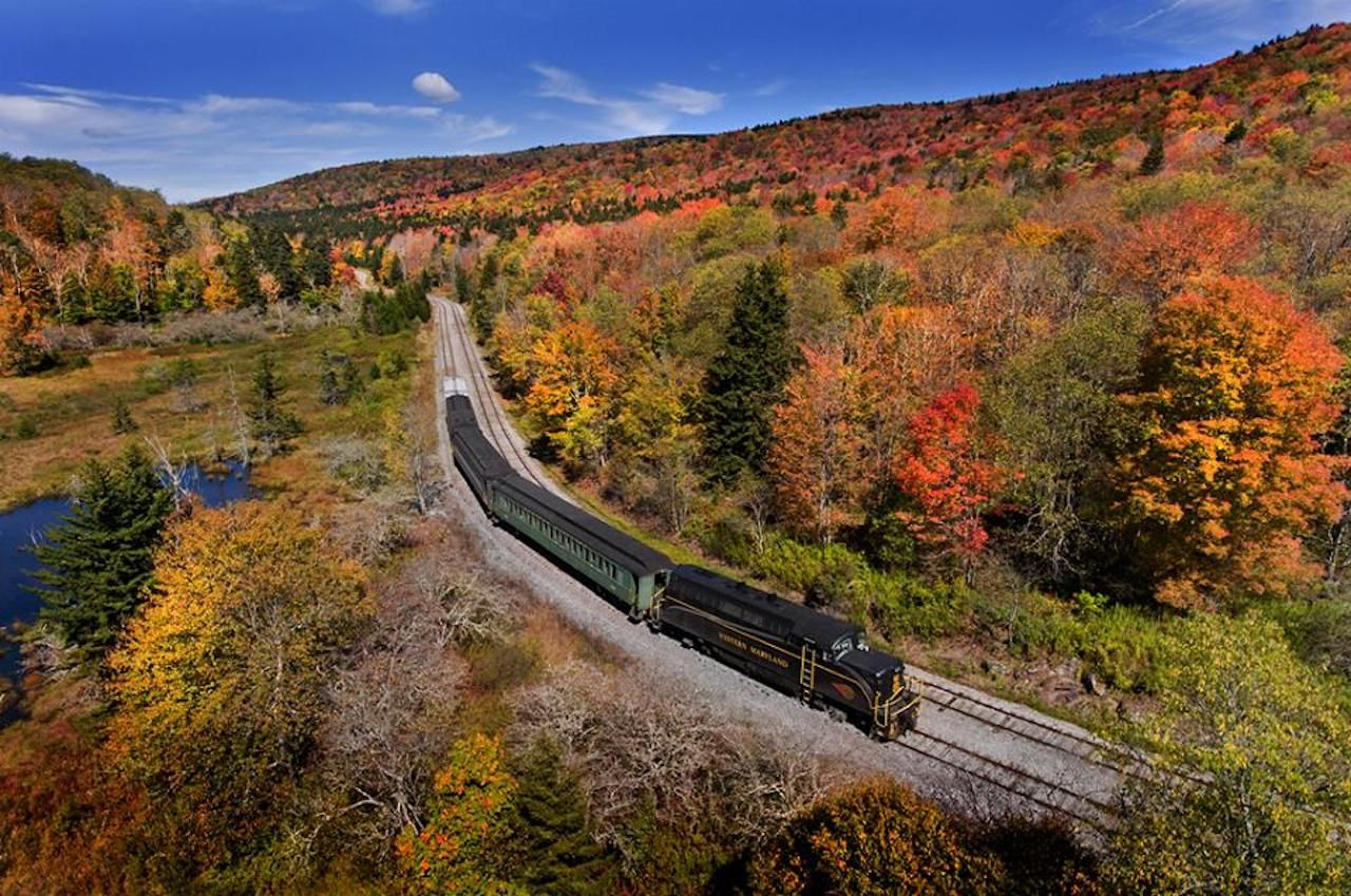A bird's eye view of a fall foliage train ride on the Durbin and Greenbrier Railroad