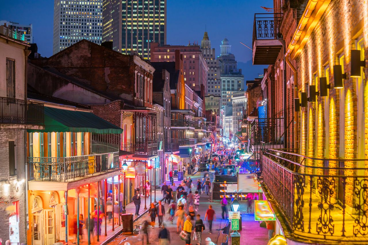Pubs and bars with neon lights in the French Quarter, New Orleans, Louisiana slang