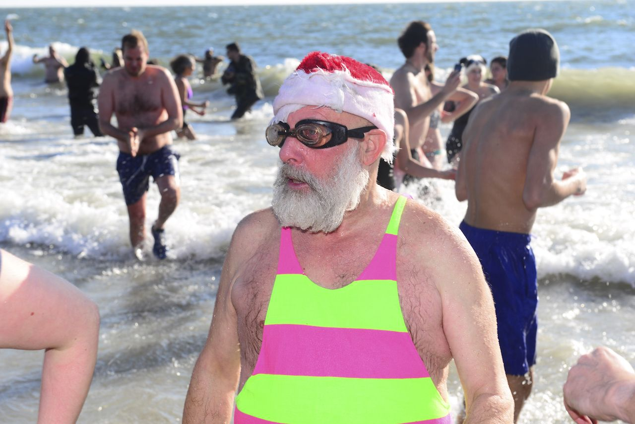 People ice swimming in the New Year's Day Polar Bear Plunge at Coney Island, New York
