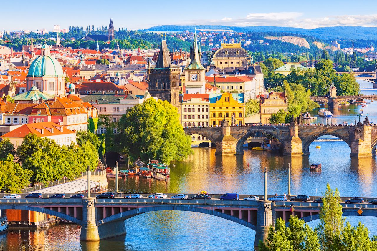Scenic summer aerial view of the Old Town pier architecture and Charles Bridge over Vltava River in Prague, Czech Republic