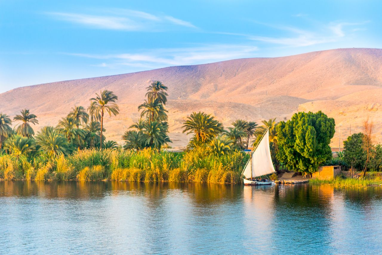 Small boat and sand dunes on the Nile