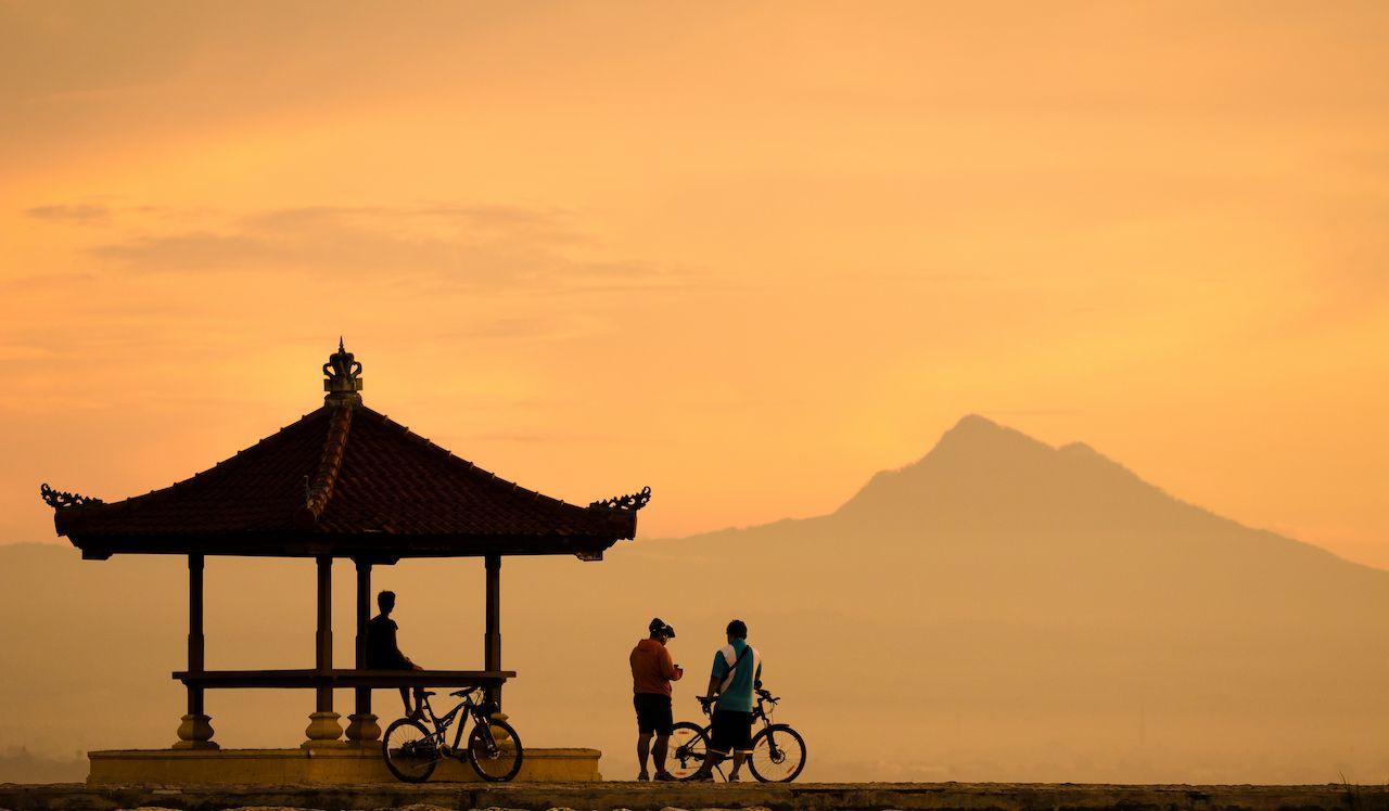 People on bikes by Karang Beach Sanur, Bali, Indonesia