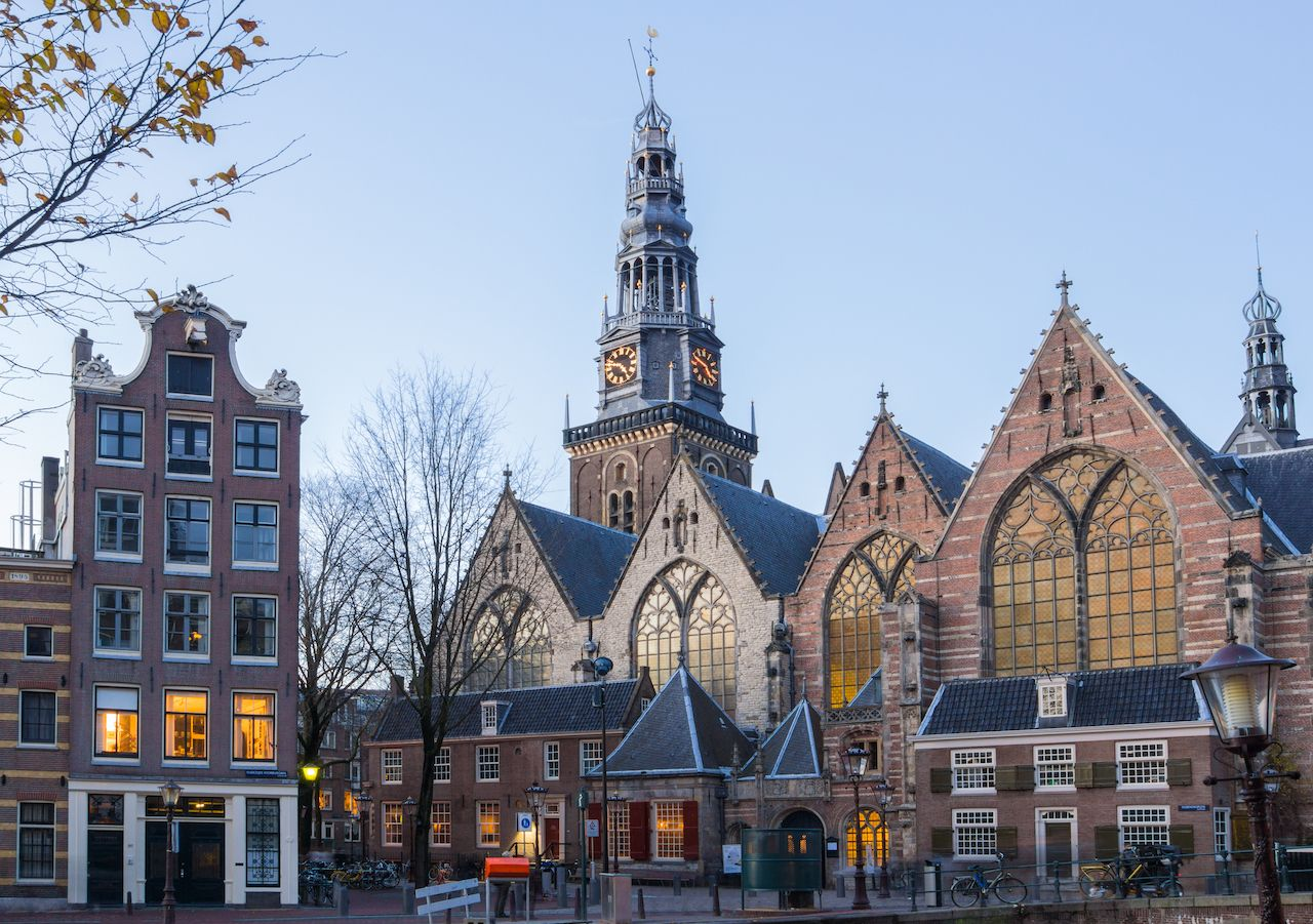 View of the Old Church in Amsterdam, red light district amsterdam