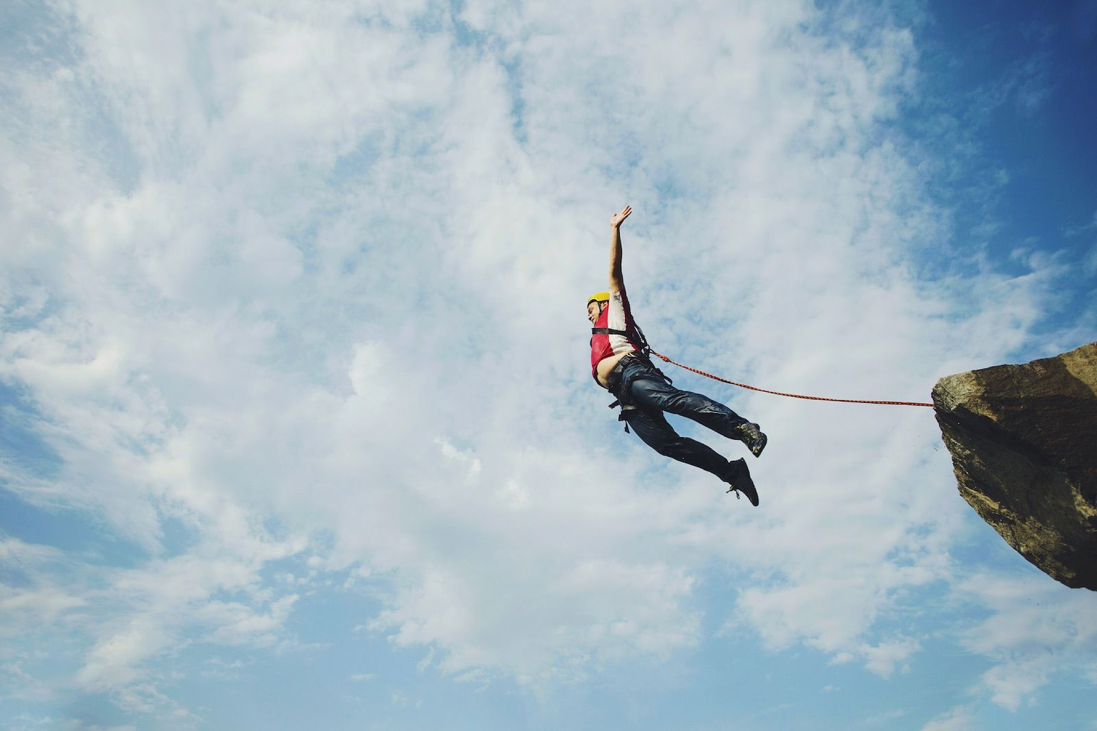 Bungee man jumps into a canyon from a cliff, adventurous things to do