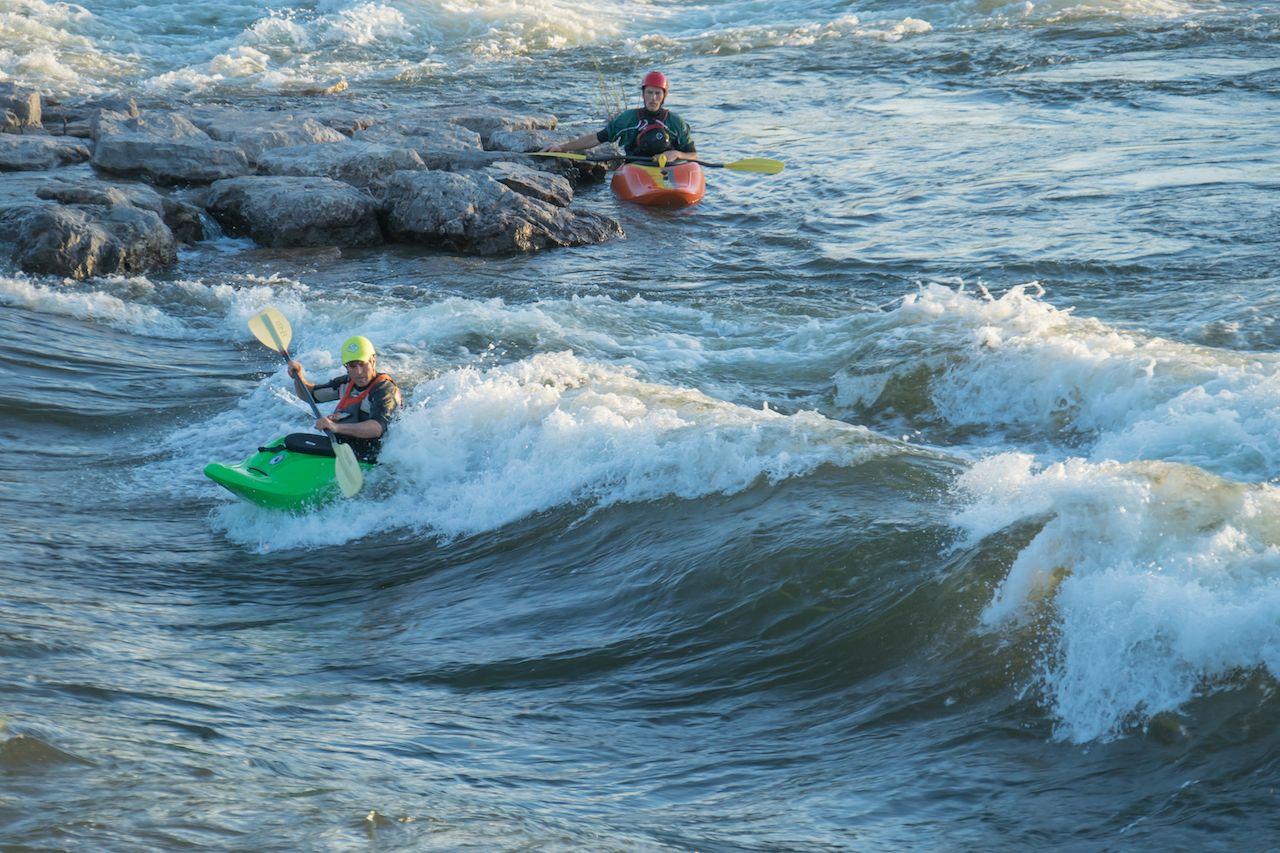 Two men kayaking Brennan's wave in Missoula Montana