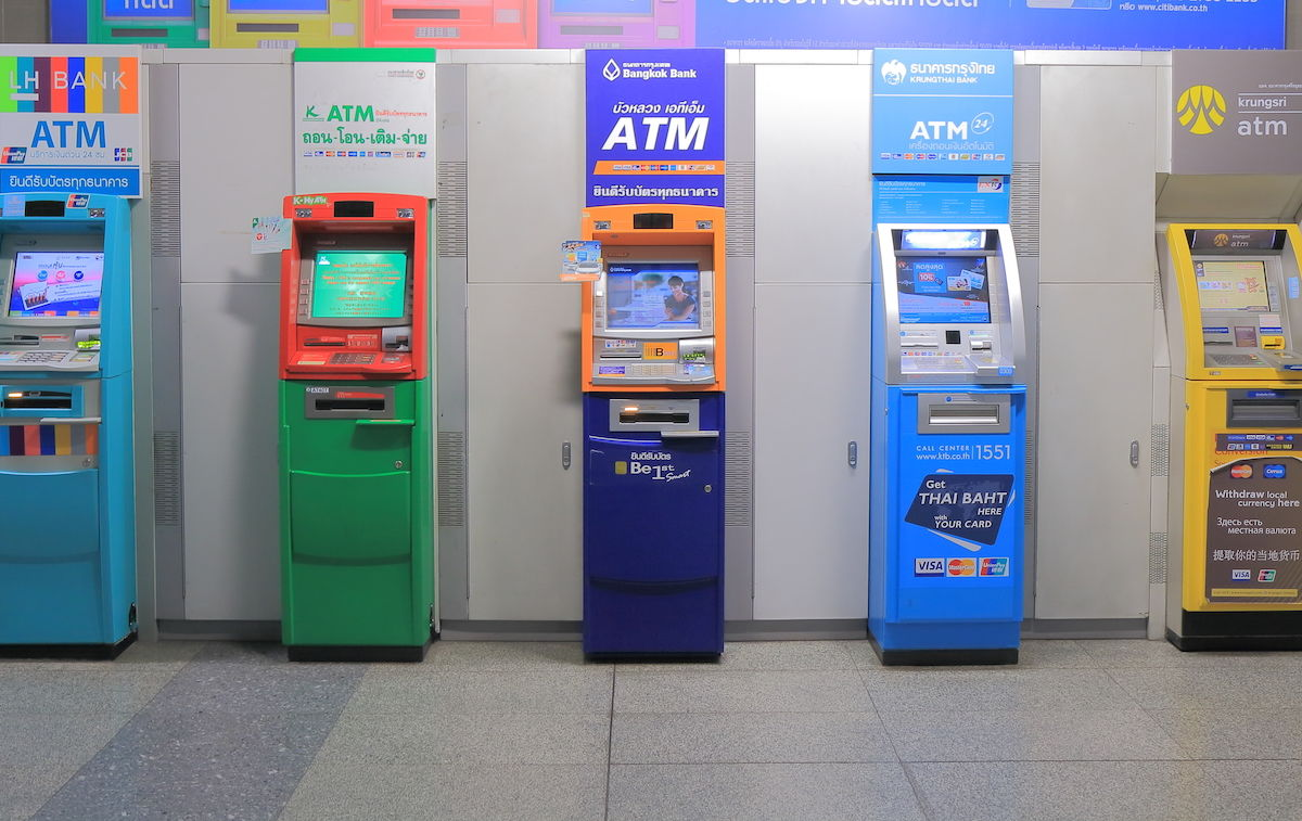 Is it better to use an ATM or money exchange service while abroad