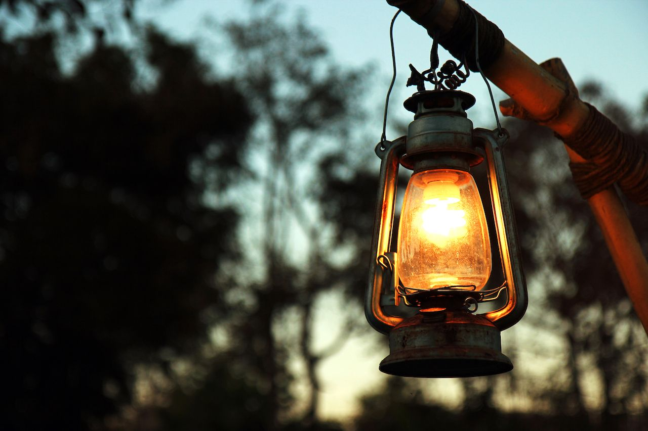 An electric lamp lights a fire-free campsite