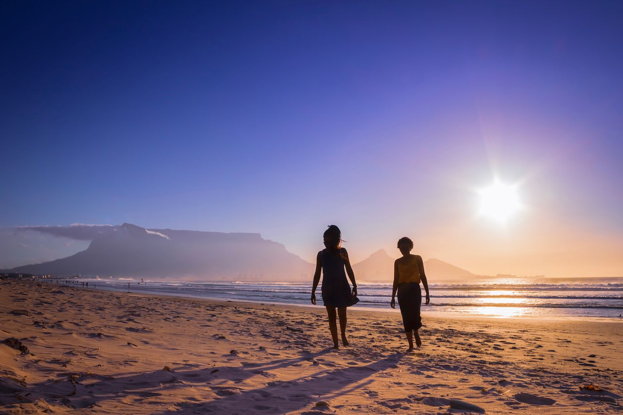 Two people on a beach in South Africa