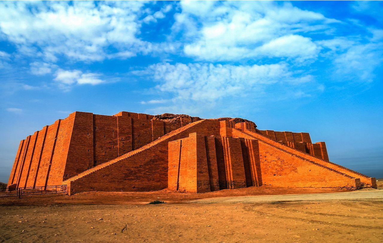 Ziggurat of Ur under blue cloudy skies