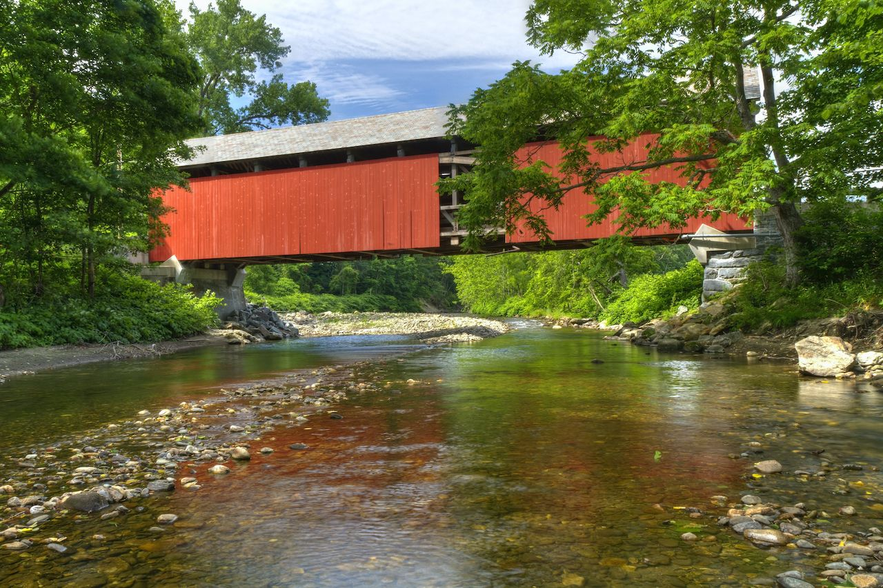 The bright red Kidder Hill Bridge is one of the few remaining covered bridges in Massachusetts