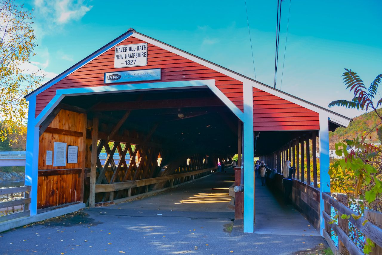 The bright red Bath-Haverhill covered bridge in New Hampshire above the Ammonoosuc River