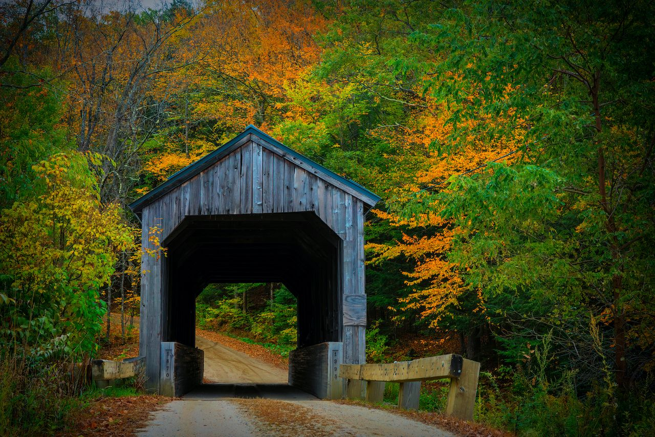Crossing Saxton River, the Kidder Hill Bridge is one of the best New England covered bridges to visit on a road trip