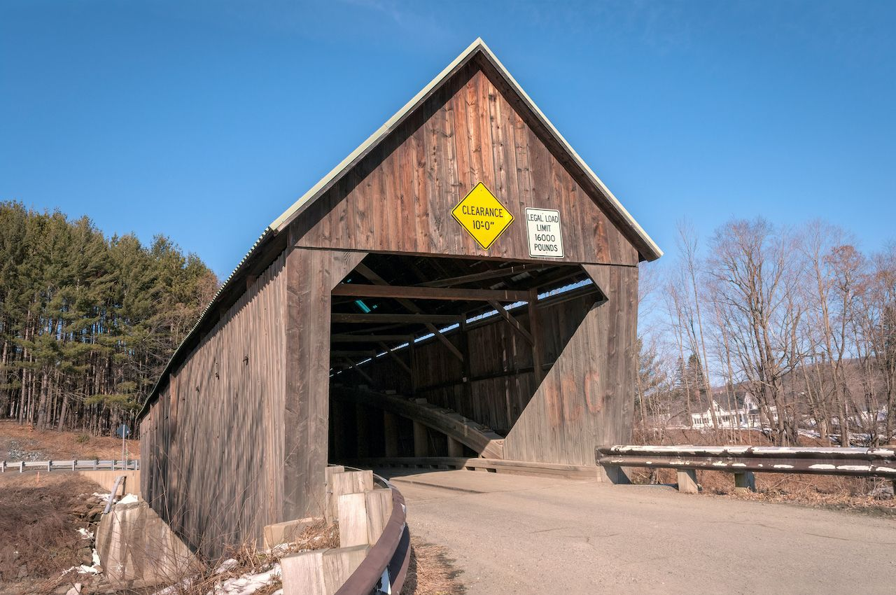 The Lincoln covered bridge in Vermont crosses over the Ottauquechee River
