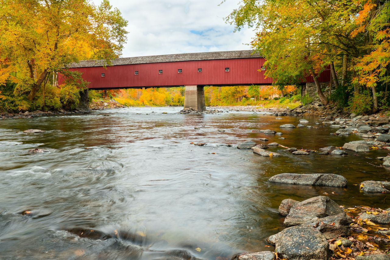 The long, red West Cornwall covered bridge in Connecticut