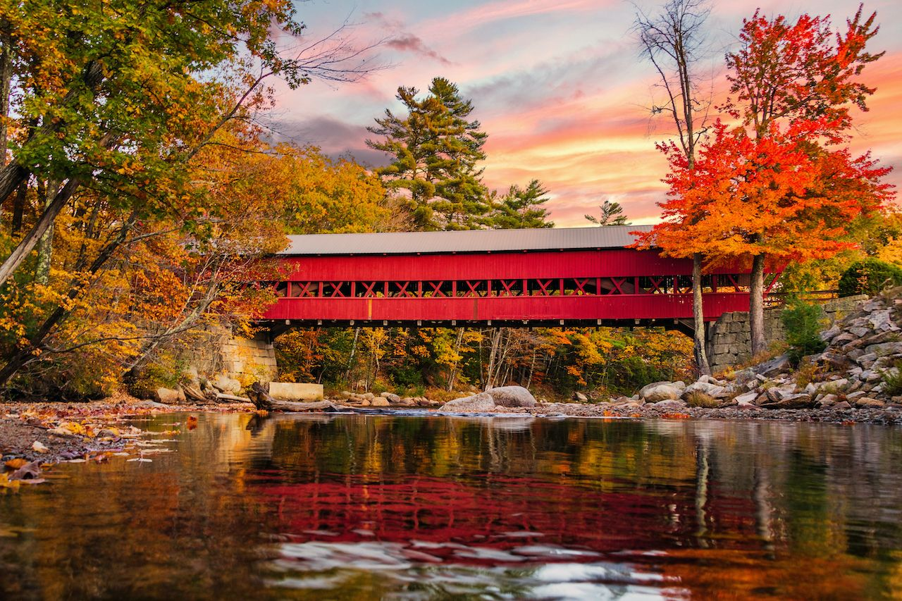The bridge red Swift River Bridge is one of the most picturesque covered bridges in New Hampshire