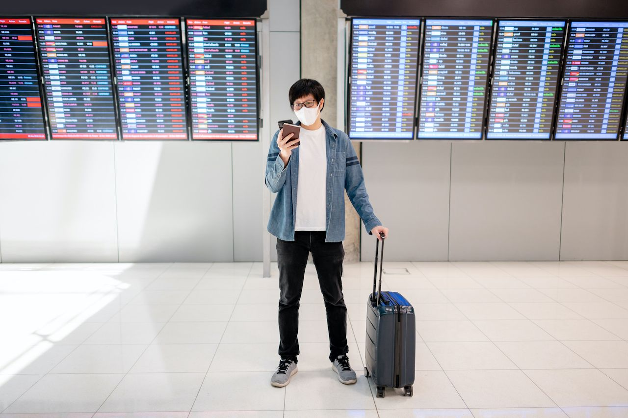 Airport traveler in a mask