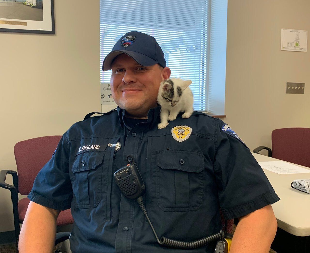 Public Safety Officer Wed England adopted a kitten rescued from Louisville airport