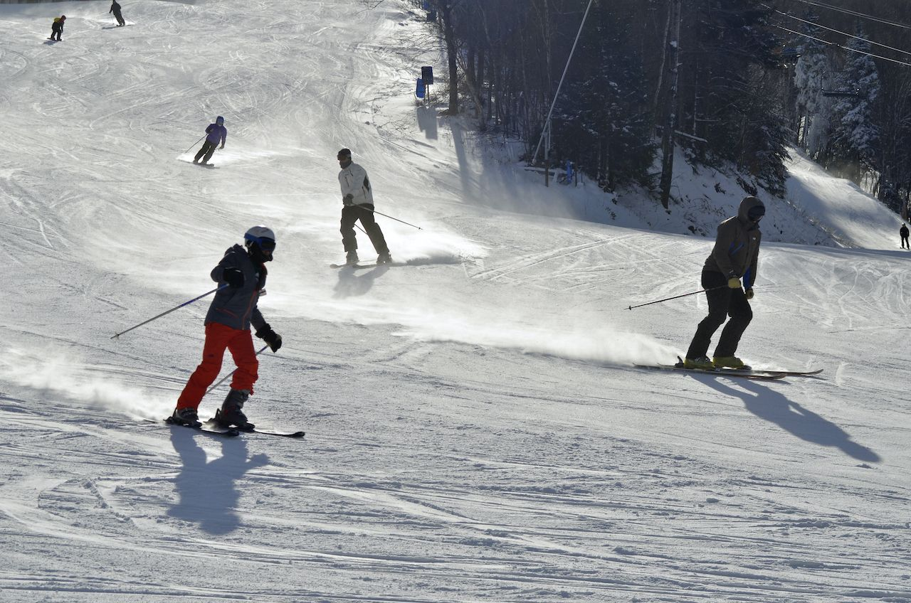 skiers on a ski hill