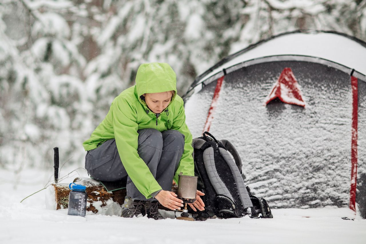 using a camping stove in the snow