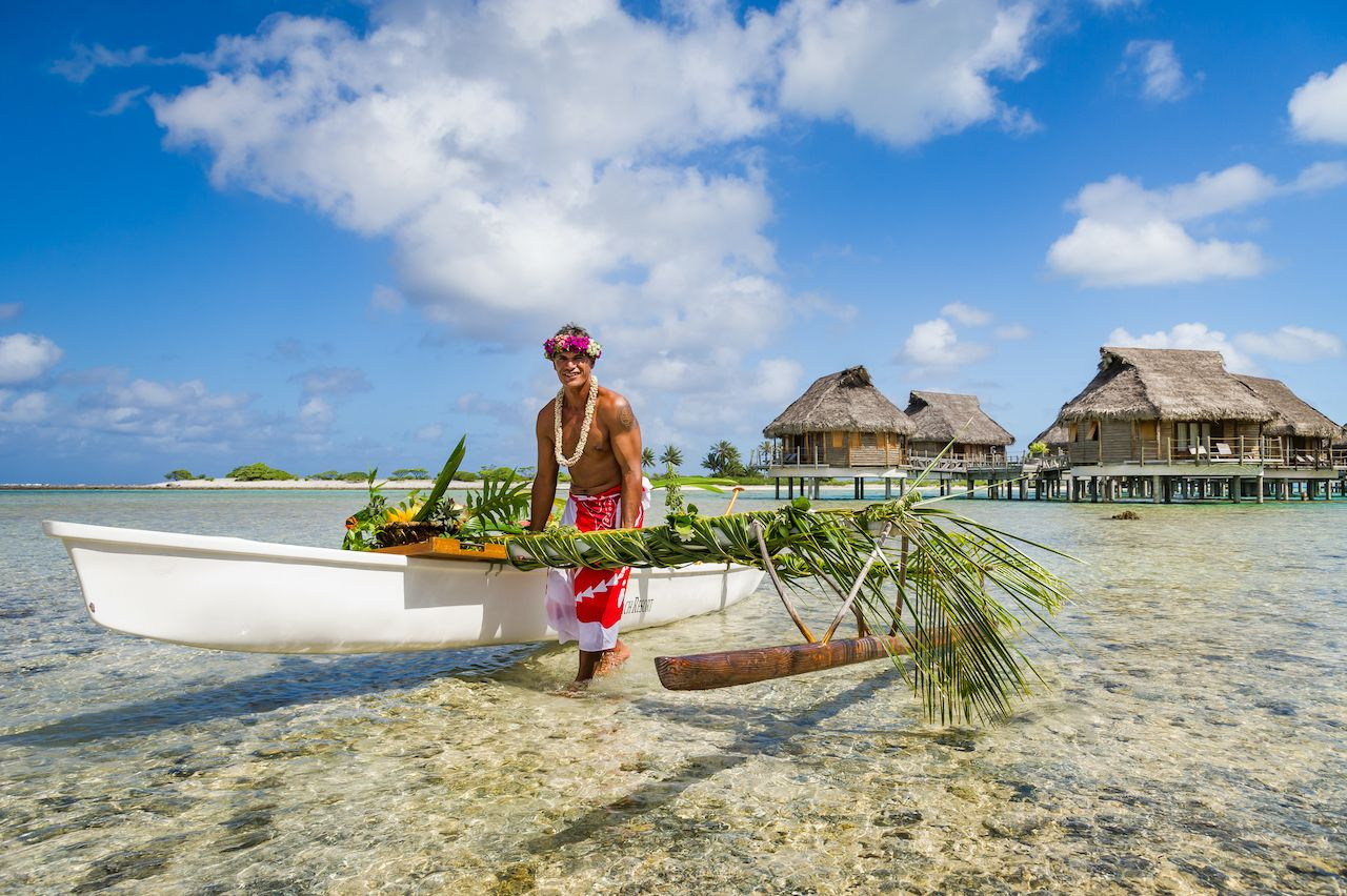 Tahitian with a boat in the water