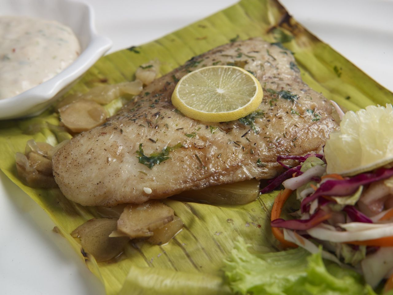 fijian fish lovo served in a white plate