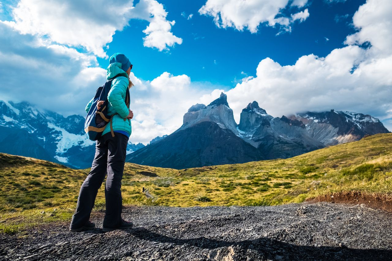 Hiker on the trail in Torres del Paine National Park, Chile