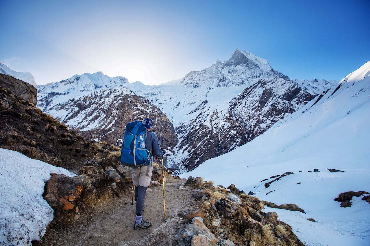 Hiker on the trek in Himalayas, Anapurna valley, Nepal