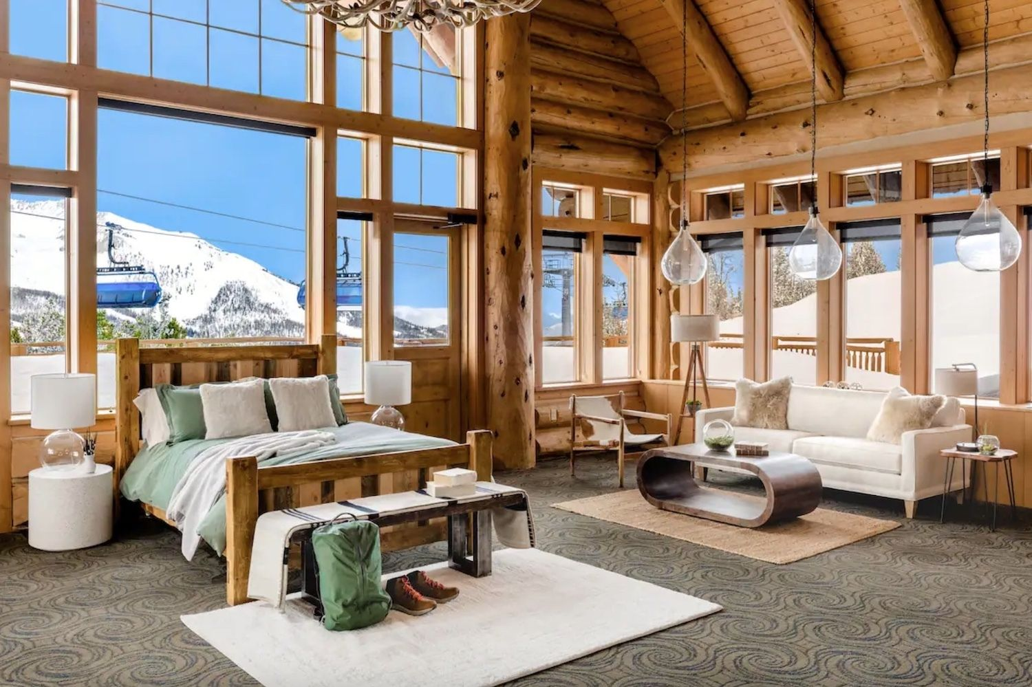 Airbnb Andesite Mountain in Big Sky, Montana parallel view of bedroom and living room, airbnb montana mountain stay