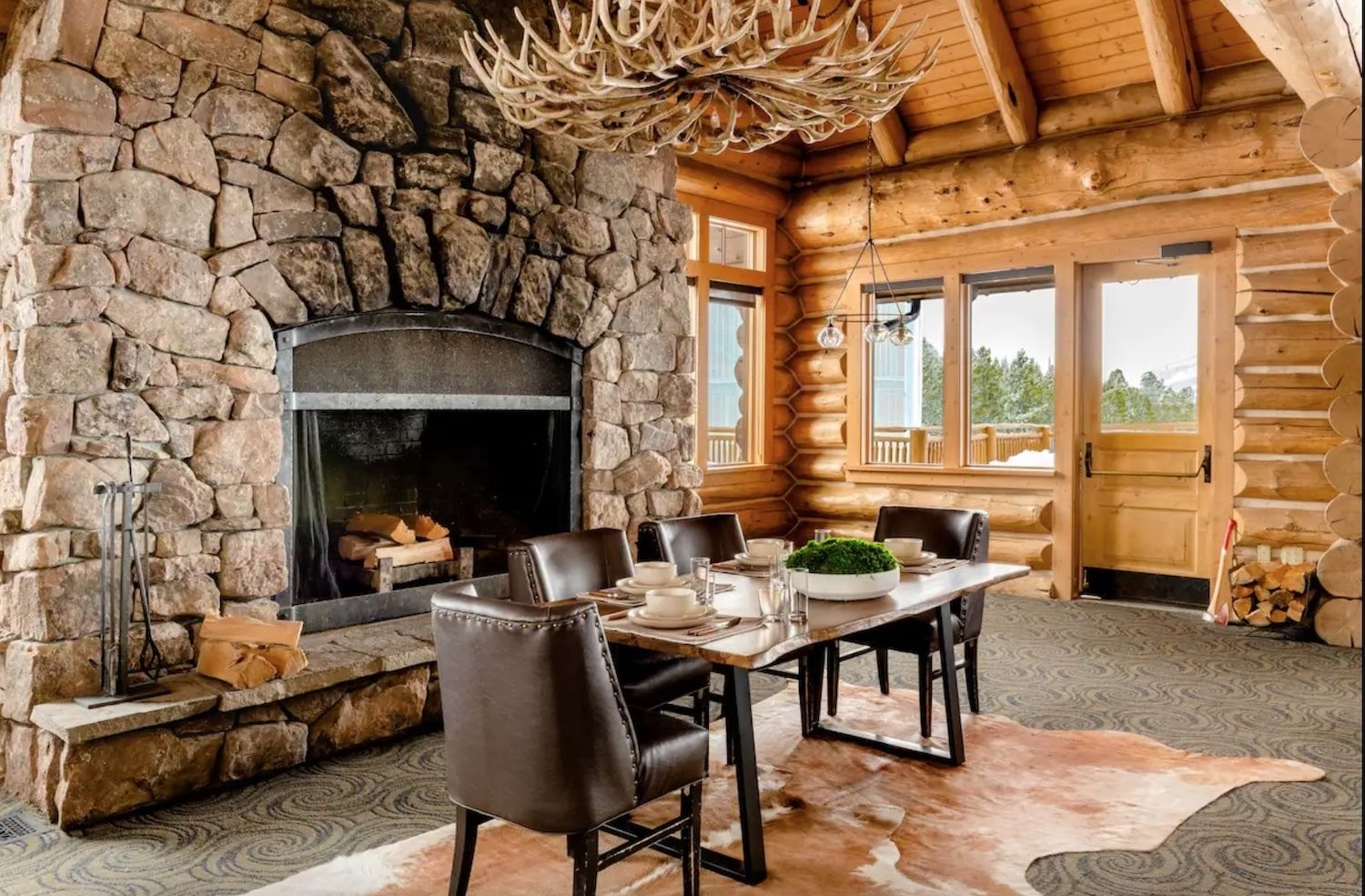 Airbnb Andesite Mountain in Big Sky, Montana fireplace and dining room, airbnb montana mountain stay