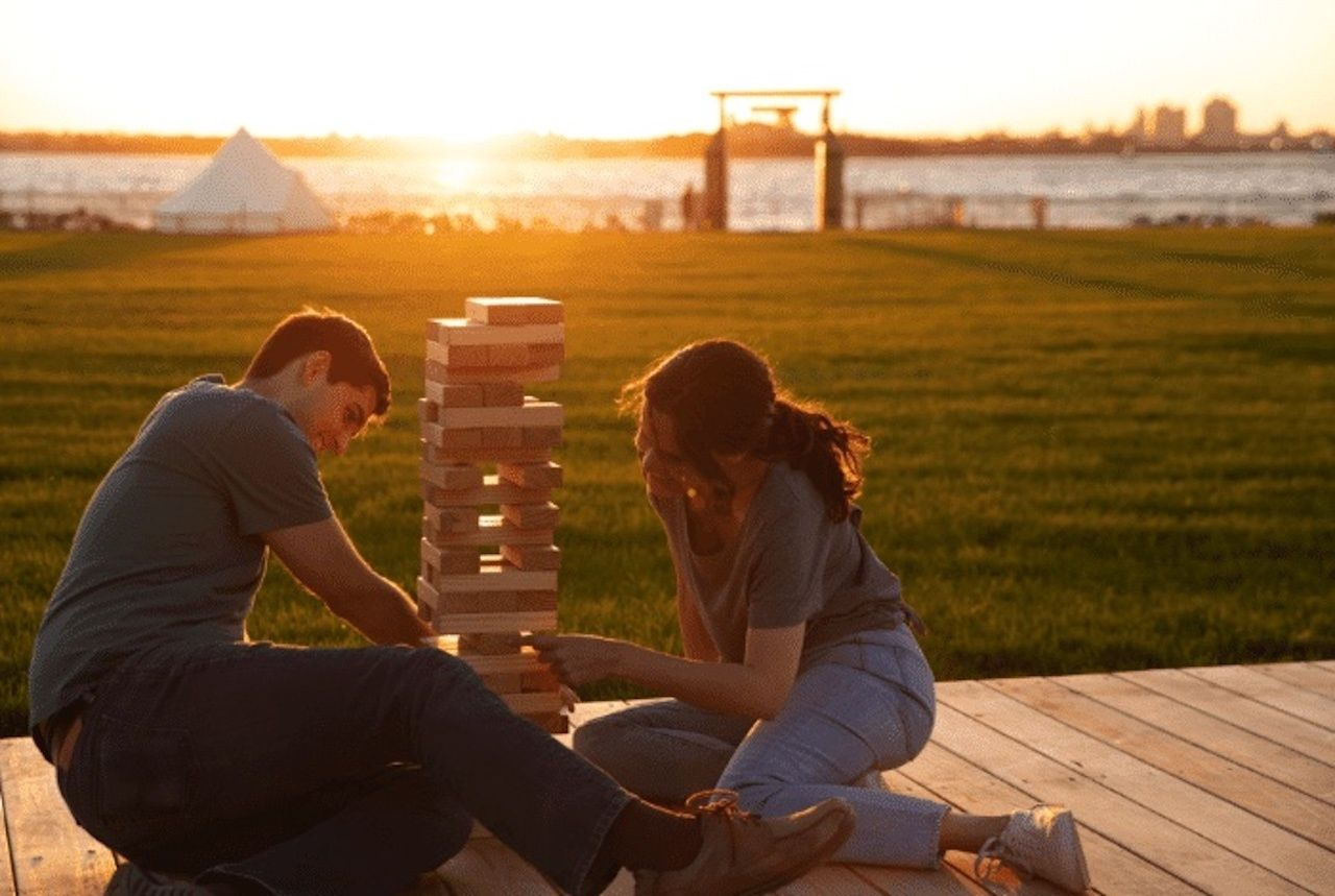 people playing jenga Collective Retreats Governors Island, outdoor events in new york city 2021