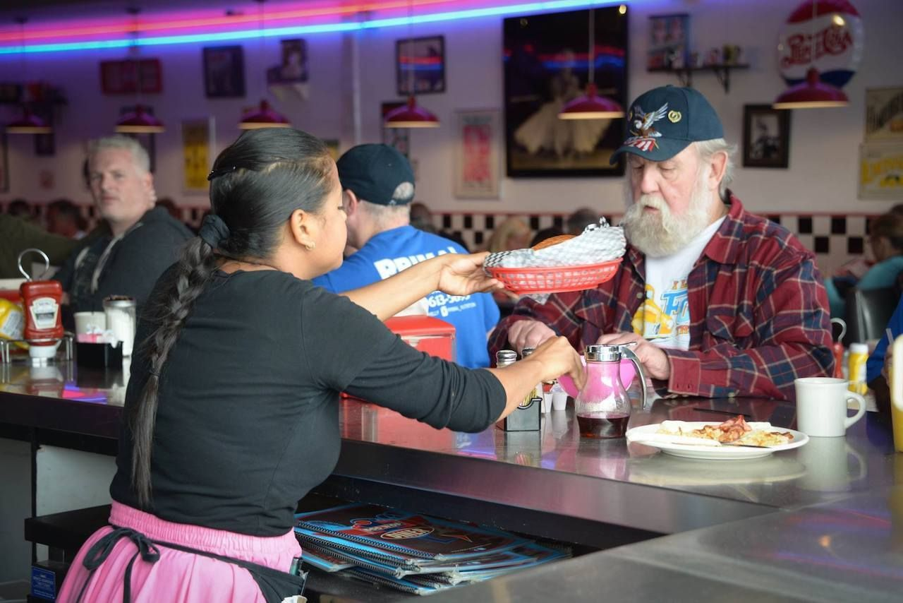 man being helped at counter at doo wop diner, best diners new jersey